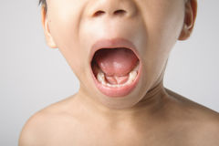 Boy showing teeth Stock Photos