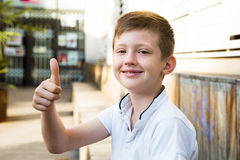 Boy showing tham up. Portrait of boy showing tham up Royalty Free Stock Images