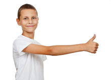 Boy showing thumb up. Boy in white T-shirt smiling and showing thumb up ower white background Stock Image