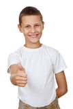 Boy showing thumb up Royalty Free Stock Photos