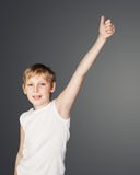 Boy Showing Thumb Up Stock Photo