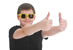 Boy showing thumb up sign. Boy with sunglasses showing thumb up sign over white background Stock Photography