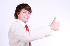 Boy showing thumbs up. Attractive caucasian boy showing thumbs up. Image isolated on black background Stock Images