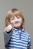 Boy showing thumbs up Stock Photos