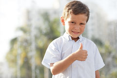 Boy showing a thumbs-up gesture Stock Photos