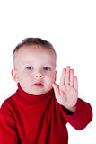 Boy showing a thumbs up gesture stop. Portrait of a boy showing a thumbs up gesture stop, isolated on white background Royalty Free Stock Photography