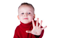 Boy showing a thumbs up gesture stop. Portrait of a boy showing a thumbs up gesture stop,  on white background Royalty Free Stock Photography