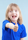 Boy showing thumbs up Royalty Free Stock Images