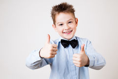 Boy showing thumbs up. Portrait of cheerful boy showing thumbs up gesture Royalty Free Stock Image