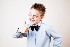 Boy showing thumbs up. Portrait of cheerful boy showing thumbs up gesture Royalty Free Stock Photos