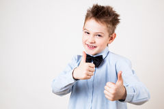 Boy showing thumbs up. Portrait of cheerful boy showing thumbs up gesture Stock Photography
