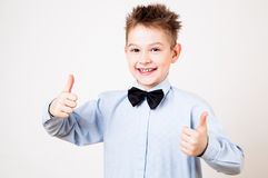 Boy showing thumbs up. Portrait of cheerful boy showing thumbs up gesture Stock Image