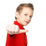 Boy showing thumbs up sign isolated Stock Photos
