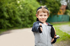 Boy showing thumbs up sign outdoors Stock Images