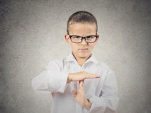Boy showing time out gesture with hands. Closeup portrait serious young man, child, making, showing time out gesture with hands, isolated grey wall background royalty free stock photography