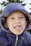 Boy showing tongue Stock Photos