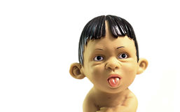 Boy showing tongue. Naughty boy figurine facing and looking to the camera and making face expressions, showing tongue isolated Stock Photo