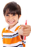 Boy showing the toothbrush Stock Image