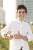 Boy showing two thumbs-up Stock Photos