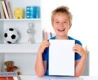 Boy showing a white sheet Stock Photos