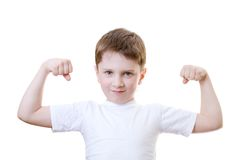 Boy showinh his strength Royalty Free Stock Photo