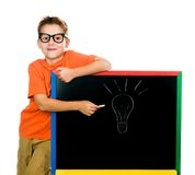 Boy shows on the board Royalty Free Stock Images