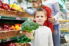 Boy shows broccoli Stock Photography
