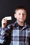 Boy shows a card with gratitude Royalty Free Stock Images