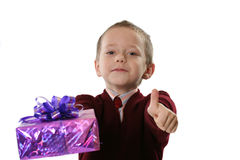 Boy shows the christmas gift. The boy in a sweater shows the christmas gift Stock Photography