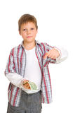Boy shows a dollar in his hands Royalty Free Stock Photos