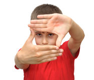 The boy shows emotion gestures Royalty Free Stock Photos