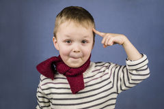 Boy shows a finger Royalty Free Stock Image