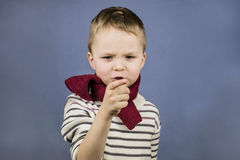 Boy shows a finger Stock Images