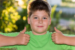 Boy shows gesture that all is well Stock Photography