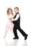 The boy shows the girl the Shoe. Royalty Free Stock Photography