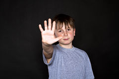Boy shows his hand to stop Royalty Free Stock Photo