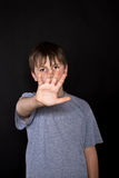 Boy shows his hand to stop Royalty Free Stock Image