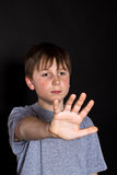 Boy shows his hand to stop Royalty Free Stock Photography