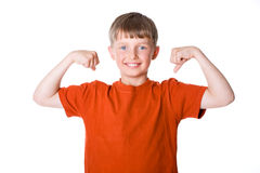 The boy shows his muscles. N a white background stock photography