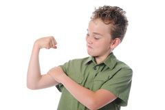 The boy shows his muscles Stock Photo