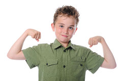 The boy shows his muscles Royalty Free Stock Photo