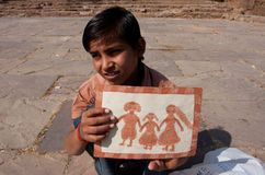 Boy shows his picture of the happy family Royalty Free Stock Photography
