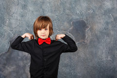 Boy shows the power Royalty Free Stock Image