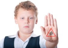 The boy shows the sign Caution Children. On a white background Royalty Free Stock Images