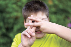 Boy shows sign gesture prison bars Royalty Free Stock Photos