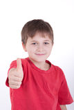 The boy shows a sign perfectly. Smiles Royalty Free Stock Images
