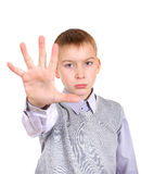 Boy shows Stop hand gesture Royalty Free Stock Photo