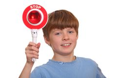 Boy shows stop sign Royalty Free Stock Image