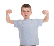 Boy shows strength. Isolated on white Royalty Free Stock Photo