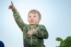 Boy shows thumb up in the evening sky. Boy shows thumb up in the evening sky Royalty Free Stock Photo